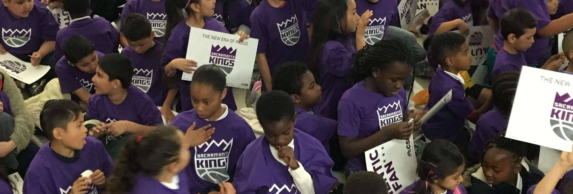 Image of Bret Harte students participate in Kings logo unveiling