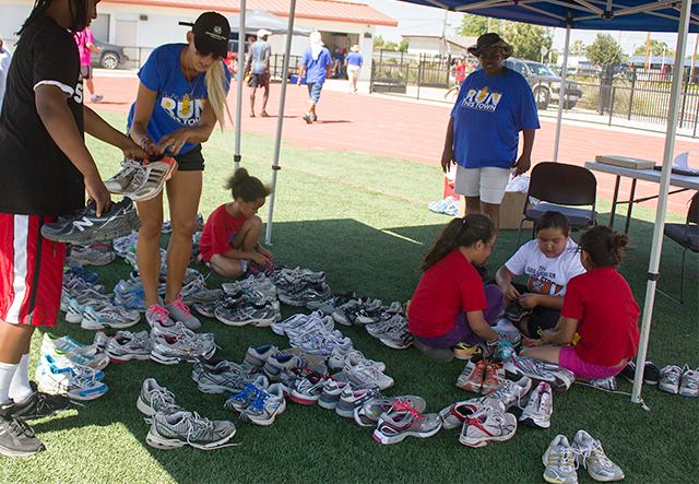 Students try on shoes donated by the Sacramento Running Association