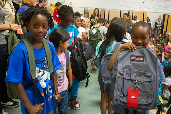 John Sloat students model their new backpacks.