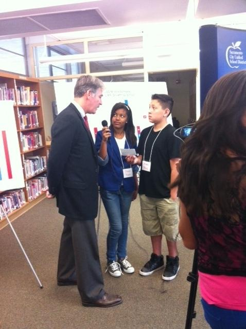 "Superintendent Raymond being interview by student reporters for Fern Bacon's ""Bulldog Bulletin."""