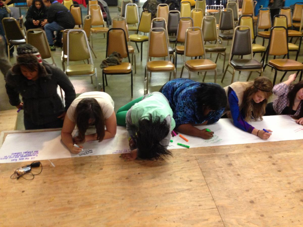 Students express their sympathies on a banner to be sent to Newtown, Connecticut