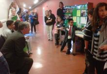 Superintendent Raymond learns about LED lights from 2nd grader