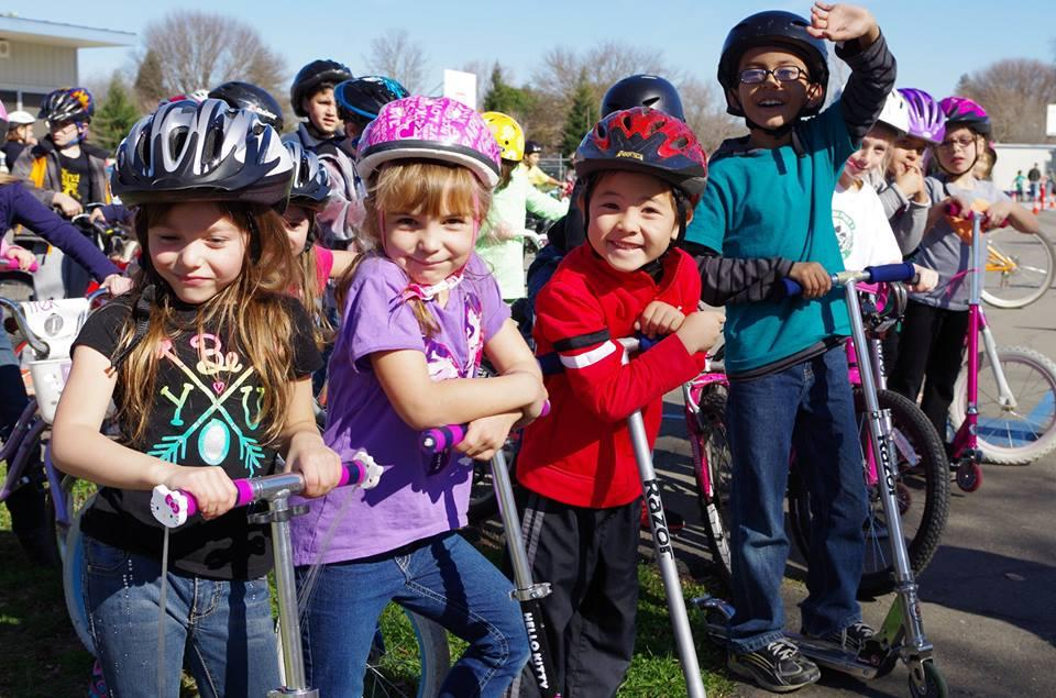 Image of Bikers, scooter-ers, have fun at Caleb Greenwood bike rodeo