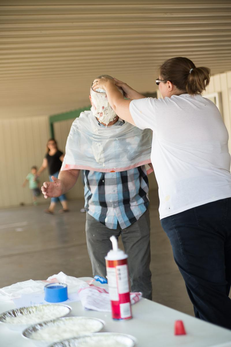 Image of Golden Empire teachers take a pie in the face to raise funds
