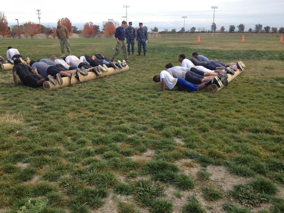 Image of Navy SEALs work with students from Rosemont, JFK and CKM